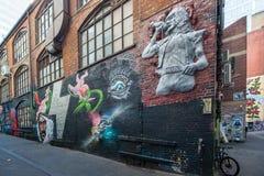 Γκράφιτι στη ΣΥΝΕΧΉ πάροδο εναλλασσόμενου ρεύματος της Μελβούρνης Στοκ Φωτογραφίες