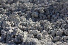 Γκρίζα πετρώδης επιφάνεια των μικρών πετρών της ανώμαλης σύστασης στοκ εικόνα