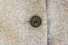 Γκρίζα σύσταση τουίντ, μαύρα κουμπιά σε ένα γκρίζο παλτό μαλλιού Στοκ Φωτογραφίες
