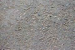 Γκρίζα σύσταση υποβάθρου πεζοδρομίων ασφάλτου με τους μικρούς βράχους στοκ φωτογραφίες