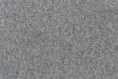 Γκρίζα σύσταση υφάσματος του υποβάθρου κλωστοϋφαντουργικών προϊόντων επιφάνειας Στοκ Φωτογραφία