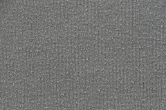 Γκρίζα σύσταση υφάσματος του υποβάθρου κλωστοϋφαντουργικών προϊόντων επιφάνειας Στοκ Εικόνα