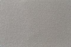 Γκρίζα σύσταση υφάσματος του υποβάθρου κλωστοϋφαντουργικών προϊόντων επιφάνειας Στοκ Εικόνες