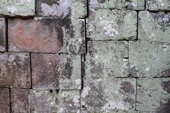 Γκρίζα φωτογραφία σύστασης τούβλου πετρών φυσική πέτρα ανασκόπησης Ξεπερασμένη ανακούφιση βράχου Παλαιός τοίχος πετρών κτηρίου Στοκ Φωτογραφία