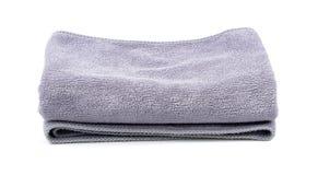 Γκρίζες πετσέτες λουτρών που απομονώνονται στο άσπρο υπόβαθρο Στοκ εικόνες με δικαίωμα ελεύθερης χρήσης