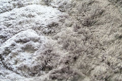 Γκρίζος γούνινος τάπητας, ως υπόβαθρο στοκ φωτογραφία