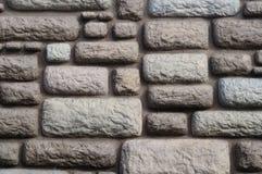 Γκρίζος διακοσμητικός τοίχος με τη μίμηση της επιφάνειας πετρών στοκ εικόνα
