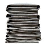 Γκρίζος διπλωμένος σωρός πετσετών που απομονώνεται στο άσπρο υπόβαθρο Στοκ Εικόνα