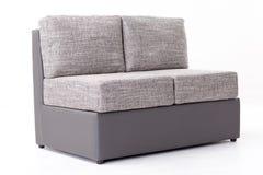 Γκρίζος καναπές Στοκ φωτογραφία με δικαίωμα ελεύθερης χρήσης