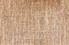 Γκρίζος-καφετιά σύσταση του υφάσματος από burlap Υφαμένη Sackcloth σύσταση Στοκ Εικόνες