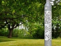 Γκρίζος σωλήνας με μια αφίσα με την εικόνα των χεριών Στοκ εικόνες με δικαίωμα ελεύθερης χρήσης