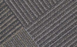 Γκρίζος τάπητας με τις διαγώνιες γραμμές στοκ φωτογραφία