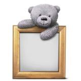 Γκρίζος teddy χαμόγελου αντέχει με το χρυσό πρότυπο πλαισίων συνόρων Στοκ φωτογραφία με δικαίωμα ελεύθερης χρήσης
