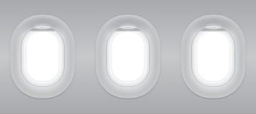 Γκρίζο κενό αεροπλάνο παραθύρων τρία Στοκ εικόνα με δικαίωμα ελεύθερης χρήσης