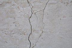 Γκρίζο συγκεκριμένο υπόβαθρο σύστασης ζημία Ραγισμένη ανασκόπηση τοίχων πετρών στοκ εικόνες