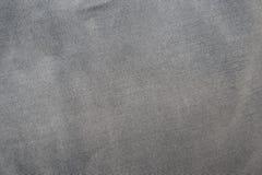 Γκρίζο υπόβαθρο επιφάνειας υφάσματος Στοκ Φωτογραφία