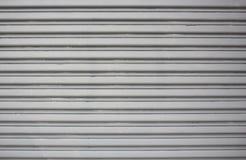 Γκρίζο υπόβαθρο πορτών γκαράζ Στοκ Εικόνα
