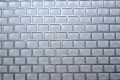 γκρίζο υπόβαθρο στα ορθογώνια όπως τα τούβλα στοκ φωτογραφίες