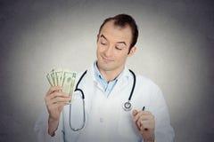 Γκρινιάρικα άπληστα φιλάργυρα χρήματα εκμετάλλευσης υγειονομικής περίθαλψης επαγγελματικά Στοκ Εικόνα