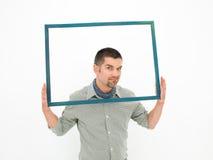 Γκρινιάρικο άτομο που κρατά ένα πλαίσιο Στοκ φωτογραφία με δικαίωμα ελεύθερης χρήσης