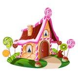 Γλυκό λίγο σπίτι με τη σοκολάτα και διακοσμημένος με τα φρούτα ελεύθερη απεικόνιση δικαιώματος