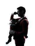 Γονείς με τη σκιαγραφία μωρών Στοκ φωτογραφία με δικαίωμα ελεύθερης χρήσης