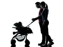 Γονείς με τη σκιαγραφία μωρών Στοκ Φωτογραφίες