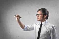 Γράφοντας επιχειρηματίας Στοκ Εικόνες