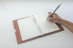 Γράφοντας ημερολόγιο Στοκ φωτογραφία με δικαίωμα ελεύθερης χρήσης