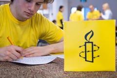 Γράψτε για τα δικαιώματα, μεγαλύτερο γεγονός των ανθρώπινων δικαιωμάτων της Διεθνούς Αμνηστίας στοκ φωτογραφίες με δικαίωμα ελεύθερης χρήσης
