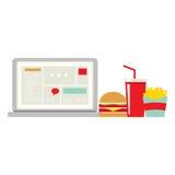 Γρήγορο φαγητό εκτός από το lap-top για τον εργαζόμενο Στοκ φωτογραφίες με δικαίωμα ελεύθερης χρήσης