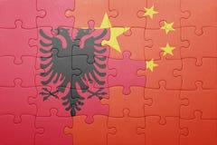 Γρίφος με τη εθνική σημαία της Αλβανίας και της Κίνας Στοκ Εικόνες