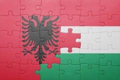 Γρίφος με τη εθνική σημαία της Αλβανίας και της Ουγγαρίας Στοκ φωτογραφία με δικαίωμα ελεύθερης χρήσης