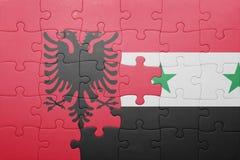 γρίφος με τη εθνική σημαία της Αλβανίας και της Συρίας Στοκ εικόνα με δικαίωμα ελεύθερης χρήσης