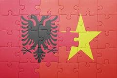 Γρίφος με τη εθνική σημαία της Αλβανίας και του Βιετνάμ Στοκ Φωτογραφίες