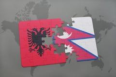 γρίφος με τη εθνική σημαία της Αλβανίας και του Νεπάλ σε έναν παγκόσμιο χάρτη Στοκ Εικόνα