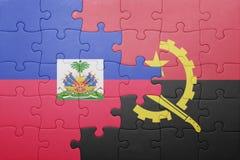γρίφος με τη εθνική σημαία της Ανγκόλα και της Αϊτής Στοκ φωτογραφίες με δικαίωμα ελεύθερης χρήσης