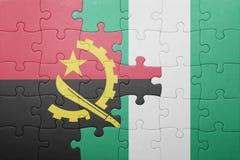 γρίφος με τη εθνική σημαία της Ανγκόλα και της Νιγηρίας Στοκ φωτογραφίες με δικαίωμα ελεύθερης χρήσης