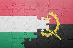 γρίφος με τη εθνική σημαία της Ανγκόλα και της Ουγγαρίας Στοκ Φωτογραφίες