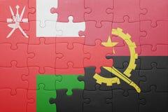 γρίφος με τη εθνική σημαία της Ανγκόλα και του Ομάν Στοκ φωτογραφία με δικαίωμα ελεύθερης χρήσης
