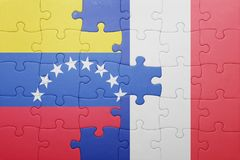 Γρίφος με τη εθνική σημαία της Βενεζουέλας και της Γαλλίας Στοκ εικόνα με δικαίωμα ελεύθερης χρήσης