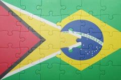 Γρίφος με τη εθνική σημαία της Βραζιλίας και της Γουιάνας Στοκ φωτογραφία με δικαίωμα ελεύθερης χρήσης