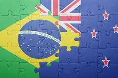 Γρίφος με τη εθνική σημαία της Βραζιλίας και της Νέας Ζηλανδίας Στοκ Φωτογραφία