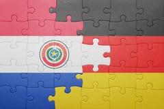 Γρίφος με τη εθνική σημαία της Γερμανίας και της Παραγουάης Στοκ εικόνα με δικαίωμα ελεύθερης χρήσης