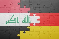 Γρίφος με τη εθνική σημαία της Γερμανίας και του Ιράκ Στοκ Φωτογραφίες