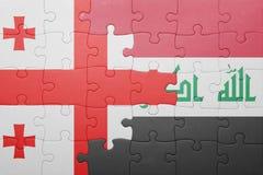 γρίφος με τη εθνική σημαία της Γεωργίας και του Ιράκ Στοκ φωτογραφία με δικαίωμα ελεύθερης χρήσης