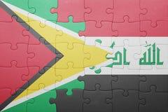 γρίφος με τη εθνική σημαία της Γουιάνας και του Ιράκ Στοκ Εικόνα