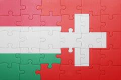 Γρίφος με τη εθνική σημαία της Ελβετίας και της Ουγγαρίας Στοκ φωτογραφίες με δικαίωμα ελεύθερης χρήσης