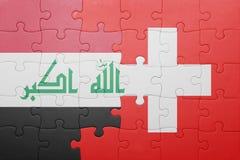 Γρίφος με τη εθνική σημαία της Ελβετίας και του Ιράκ Στοκ Εικόνες
