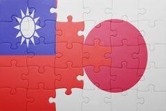Γρίφος με τη εθνική σημαία της Ιαπωνίας και της Ταϊβάν Στοκ Εικόνες